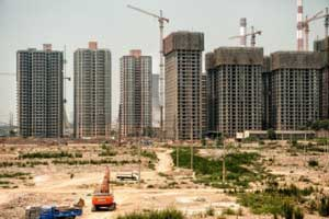 China property bound for stricter rules as home prices rise